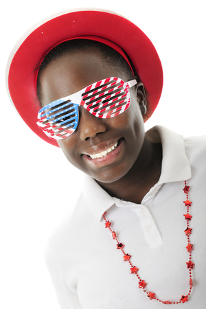 louvered: Close-up of a pretty tween girl dressed to celebrate America with red, white and blue louvered sun glasses.  On a white background.
