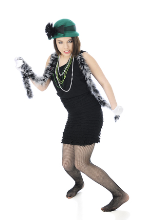 A beautiful teen flapper giving the view the eye as she dances in her fish-net stockinged feet.  On a white background.
