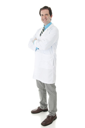 looking at viewer: A full length image of a happy doctor in dress shirt, tie and lab coat looking at the viewer.  On a white background.