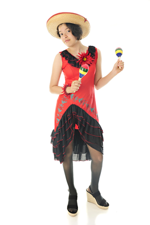 mexican dress: An attractive teen girl dancing with maracas in her red and black Mexican dress and straw sombrero.  On a white background.