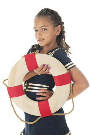 sassy: A pretty elementary girl in a sailor dress.  Shes looking the the viewer while holding a life ring.  On a white background.
