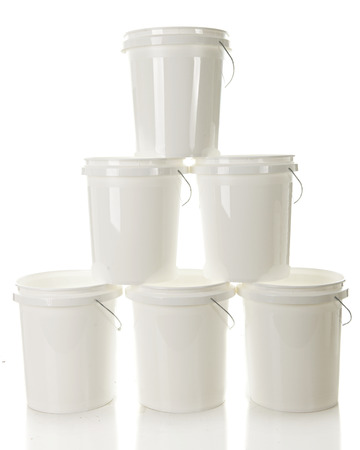 A tower of 6 white plastic buckets on a white background.