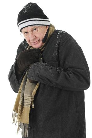 bundled: A bundled senior man  happy but cold.  On a white background.
