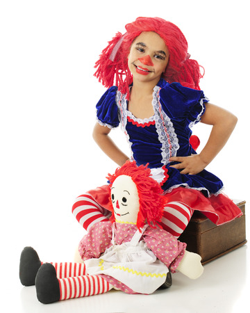 rag doll: An adorable living rag doll with her toy rag doll.  On a white background. Stock Photo