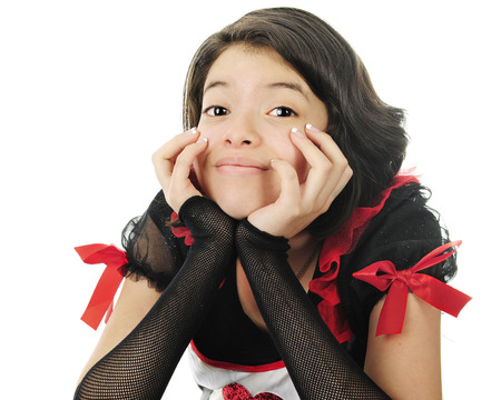 dressed up: Closeup image of a pretty young teen leaning on her hands while dressed up in red, black and white for Valentines Day.  On a white background.
