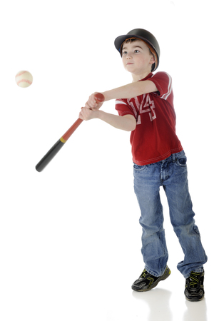 batters: A young elementary baseball batter hitting the ball.  Motion blur on bat and ball.  On a white background.
