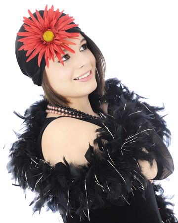 Close-up image of a beautiful teen flapper, dressed all in black with a big red flower on her hat.  On a white background.