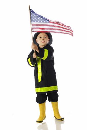 Young Flag-Waving Fireman