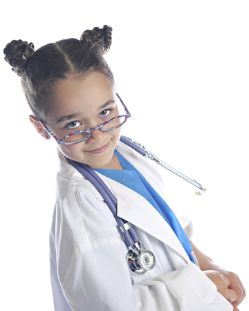 An elementary girl playing doctornurse looking over her glasses at the viewer with a smug smile. On a white background. Banco de Imagens