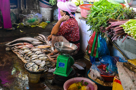 Fish and vegetables at a local asian market in Cambodia