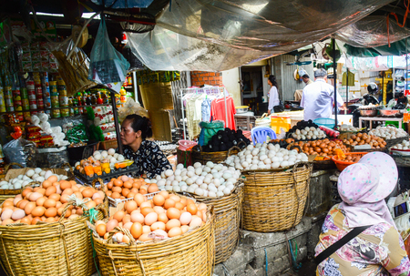 Asian street stand sells different eggs