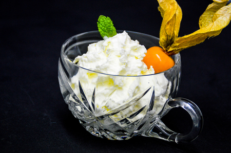 Whipped cream in glass on black background Banco de Imagens