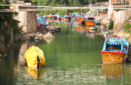 Mooring for fishing boats and canal of Vihn in Vietnam Stock Photo