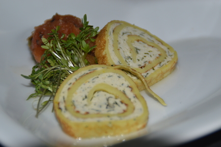 A small greeting from the kitchen. Chicken roulade, pumpkin chutney and cress