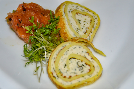 Chicken roulade as a greeting from the kitchen, also called Amuse Bouche or Amuse Gueule Stockfoto