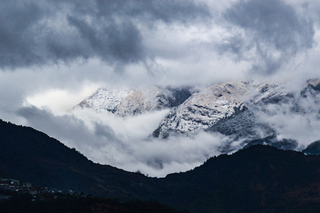 The clouds envelop the Annapurna mountain range, creating a fantastic moment Reklamní fotografie
