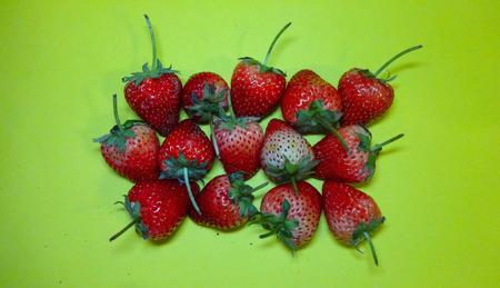 Summer strawberries together on green background Reklamní fotografie