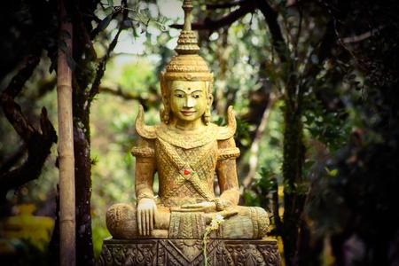 A Buddha statue in a temple setting in Battambang, Cambodia