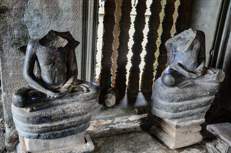 Two Buddha statues whose head was cut off in Angkor Wat