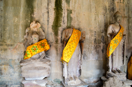 Headless Buddha statues in the temple complex Angkor Wat