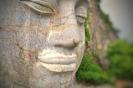 The rock-hewn Buddha head in Battambang in Cambodia Stock Photo