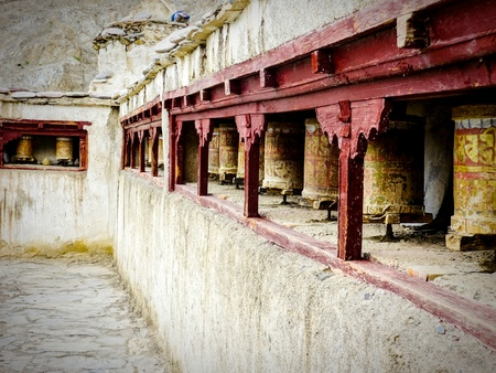 The temple walls of the 3,500-year-old Yuru Monastery in Lamayuru with its prayer wheels, Ladakh, India