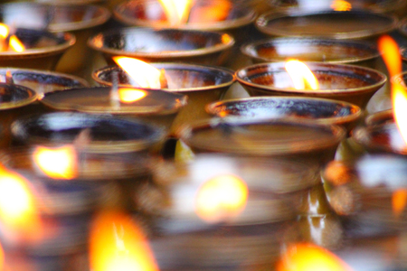 Candles are lit in the temples to believe in the dead and to strengthen their prayers Stock fotó