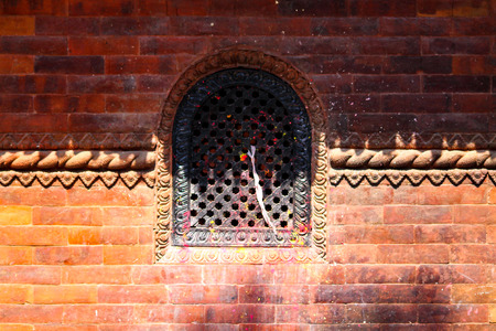 A wooden handmade temple window on Durbar Square Kathmand, Nepal Stock Photo