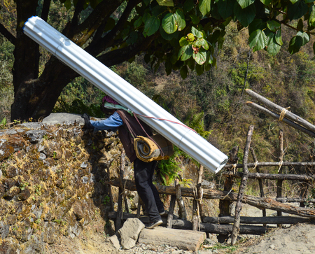 Sometimes the means do not allow any other means of transport than humans. This guy carries a roof to the mountain village.