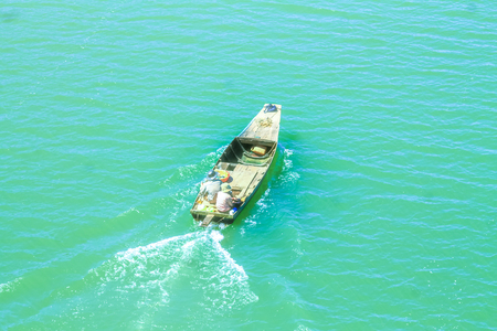 These fishermen use their smaller boat for easier access to the mainland
