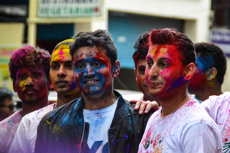 A portrait of colore covered guys at the holi festival. Pokhara, Nepal