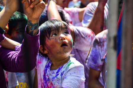 in the middle of the celebrating people, even the smallest celebrate. Holi Festival, Pokhara, Nepal