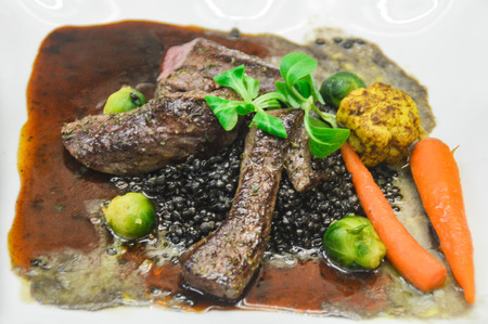 This dish comes from the west of Germany. It consists of a beluga lentil, Brussels sprouts, cauliflower and three hare fillets.