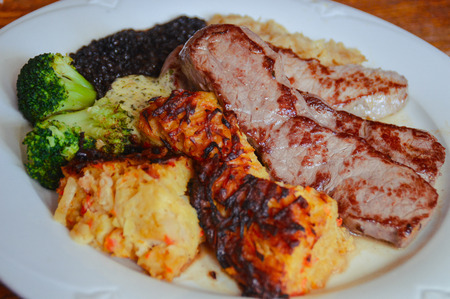 This dish comes from the west of Germany. It consists of a sauerkraut, broccoli, beluga lentils, three pseudopods and schorles. This dish is a traditional dish in the Moselle valley at Rhineland-Pflaz