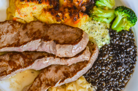 This dish comes from the west of Germany. It consists of a sauerkraut, broccoli, beluga lentils, three pseudopods and schorles. This dish is a traditional dish in the Moselle valley in Rhineland-Pflaz