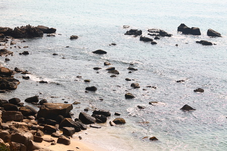 At such shorelines, the boulders are shaped by water until they slowly disappear Stok Fotoğraf