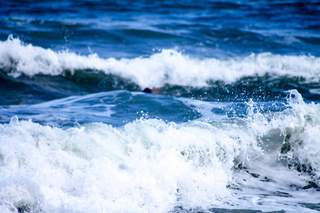 A close-up shot of waves breaking from deep blue to clear white