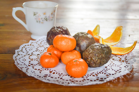 A little something for lunch. Passion fruit and tangerines served on a tablet