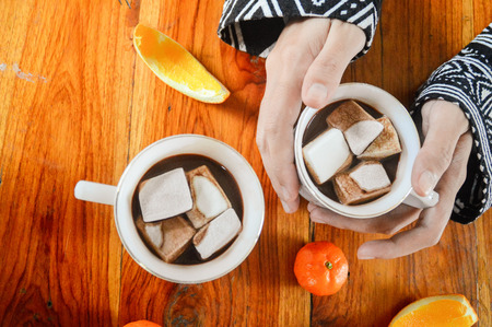 During the cold winter months, warm yourself up with a cup of hot chocolate with marshmallows Stok Fotoğraf