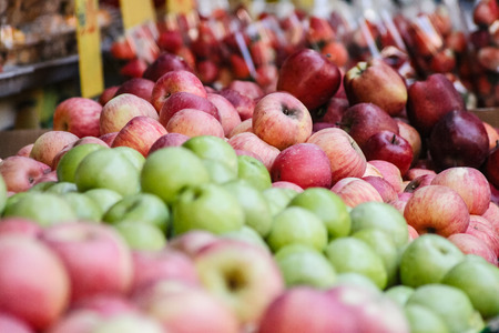 Fresh crunchy apples sorted by style are sold on the weekend market by haggling Stok Fotoğraf