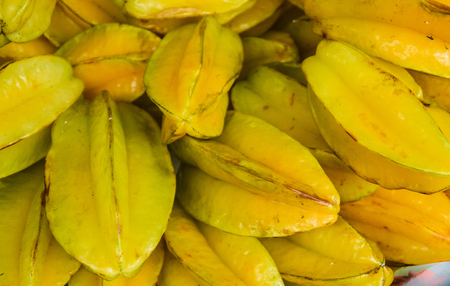 A close-up of fresh starfruit or carambola are offered on local markets in Sumatra Stok Fotoğraf