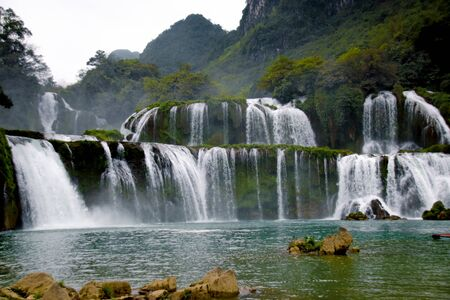 Dark and moody cinematic scenery of Ban Gioc or  Detian Falls in Cao Bang, Vietnam during the winter season