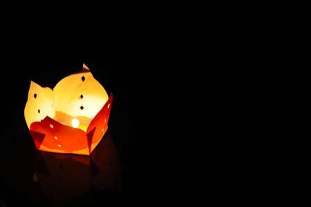 A lone lantern in the night during the Floating Lantern Festival also know as Loy Kratong or YeePeng Festival , celebrated in Thailand, Vietnam, Myanmar, Laos and Malaysia