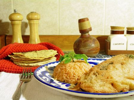 Traditional mexican dish, stuffed chili and tortillas Banco de Imagens
