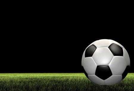 黒の背景には草の上のサッカー サッカー ボールのレンダリング 写真素材