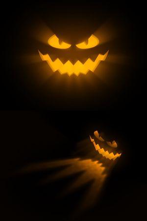 scary pumpkin: An iluminated pumpkin face on a black background