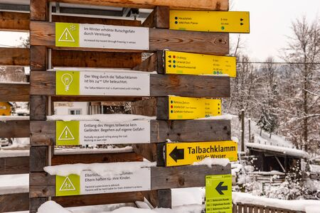 Yellow Tourist Directional Signs. Information to visitors about paths, attractions, distances and points of interest. Schladming Dachstein, Styria, Austria, Europe