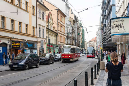 Prague, CZECH REPUBLIC - August 17,2018: Public communication, red tram, walking people in Prague City Center. Sajtókép