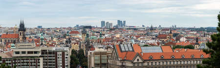 The Prague panorama. The panoramic cityscape of Czech Republic capitol on a sunny day. The detail view of modern and old part of town with traditional red rooftops. Sajtókép