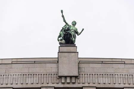 Prague, Czech Republic -August 17,2019: Ceska Narodni banka - Czech National Bank, The details of the building - sculpture at the top.